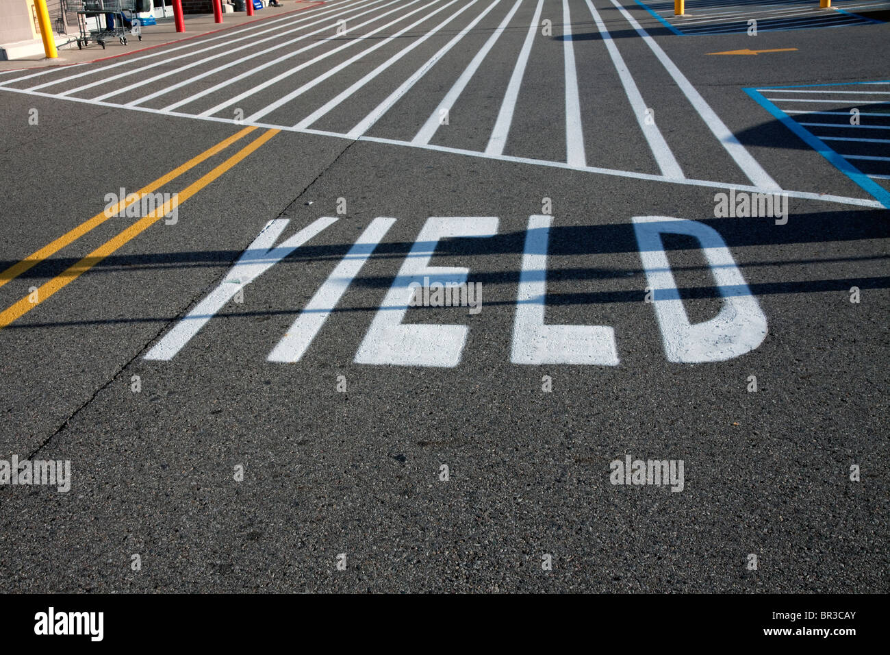 Yield sign painted on the road USA - Stock Image