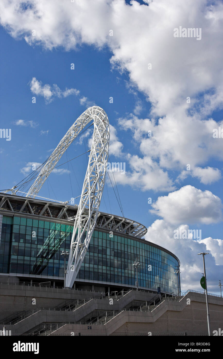 Eastern elevation of the famous London landmark of Wembley Stadium and it`s recognizable arch. - Stock Image