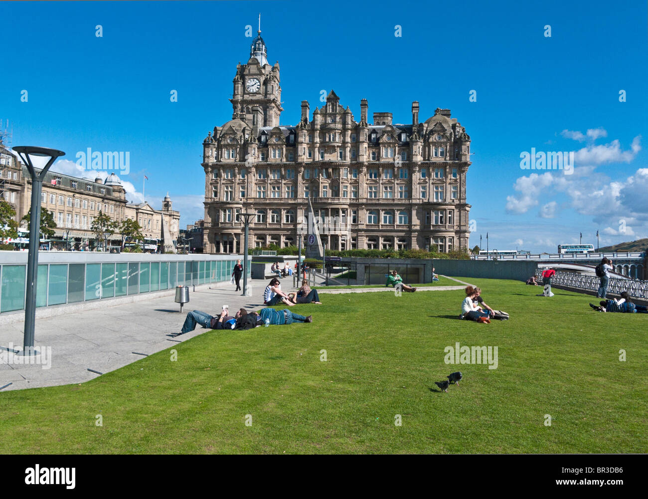 Open lawn area above Princes Mall in the Centre of Edinburgh Scotland looking towards the Balmoral Hotel - Stock Image