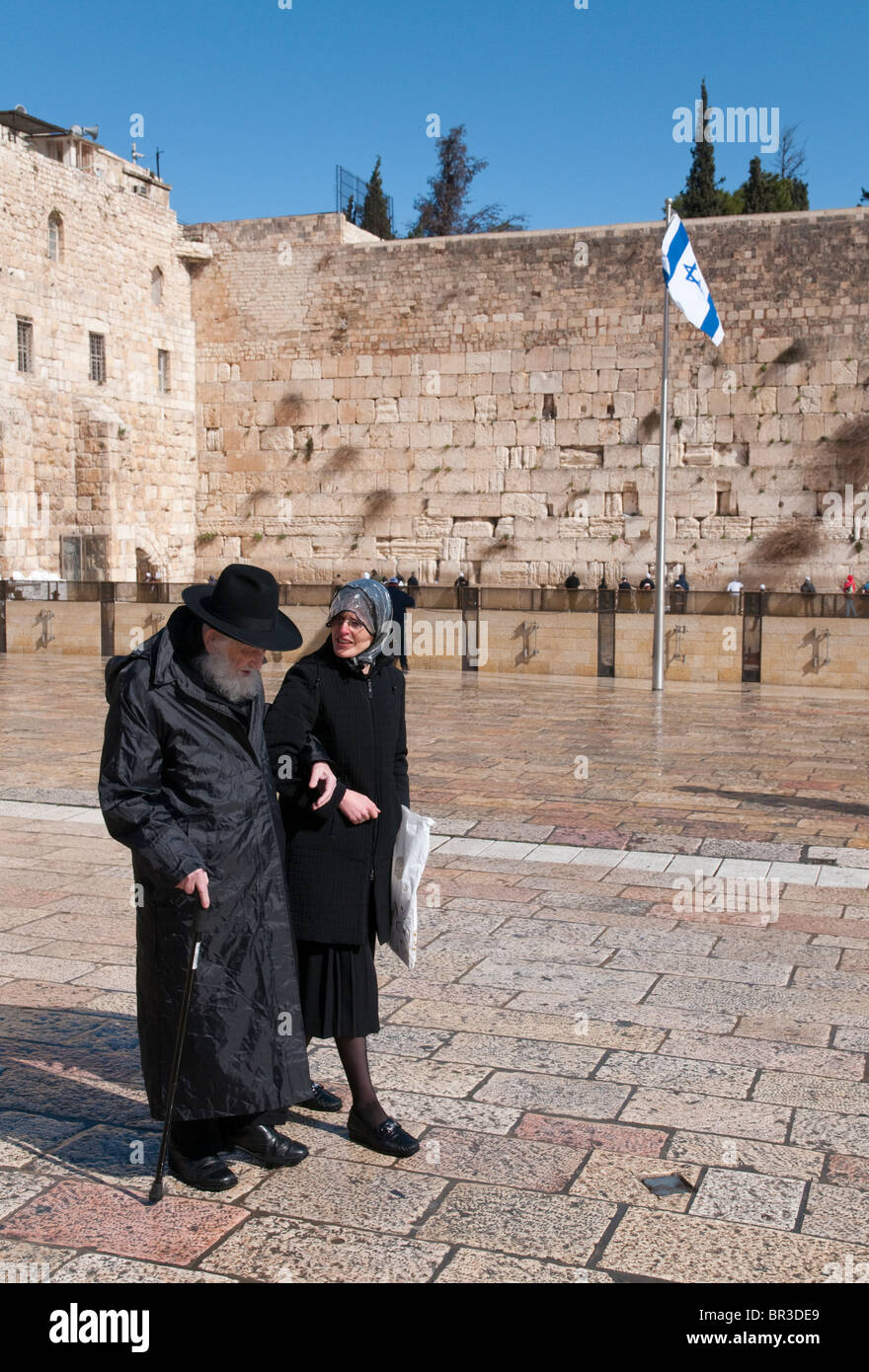 elderly orthodox jew and woman at western wall. Jerusalem Old City - Stock Image