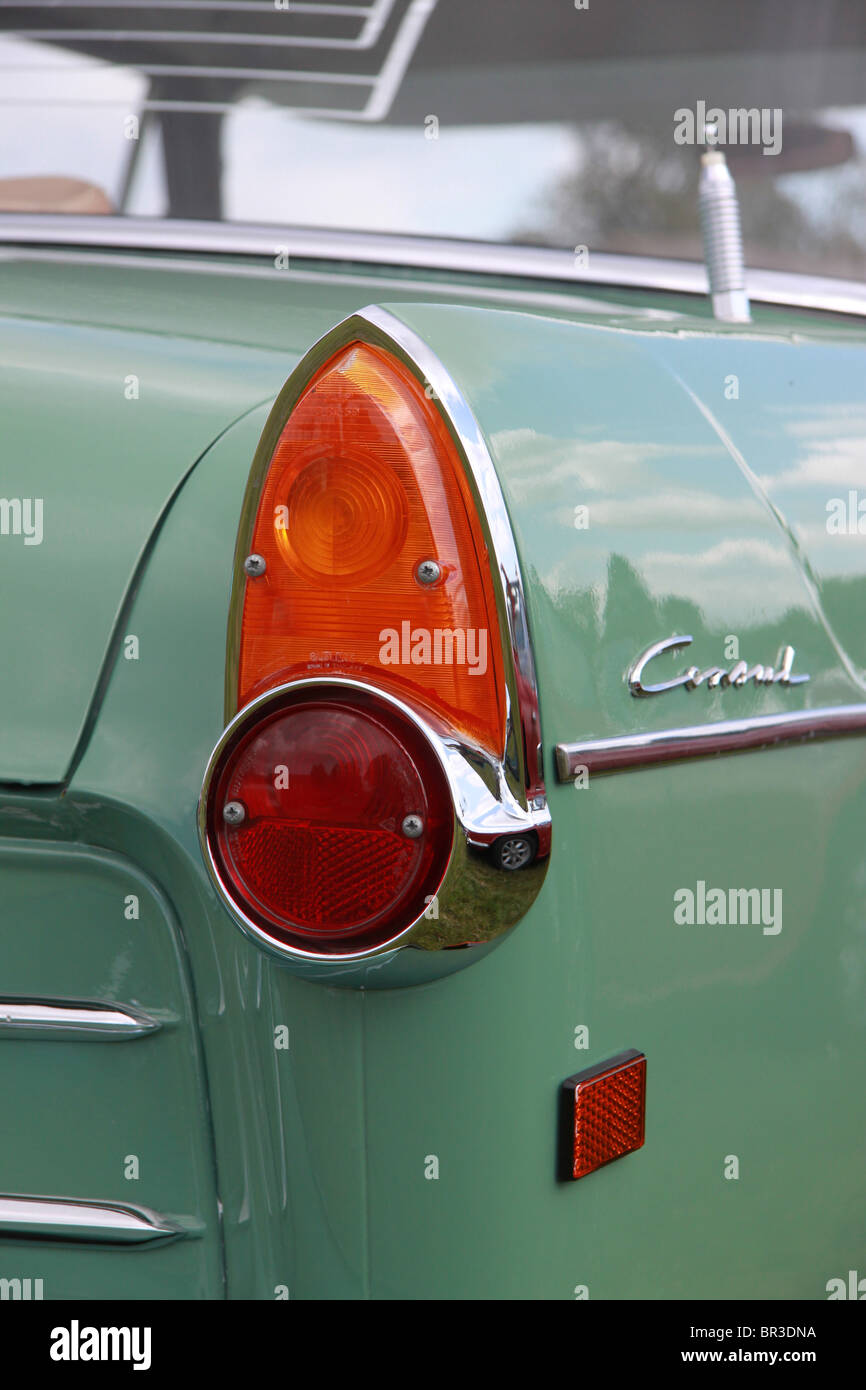 rear wing of a green Ford Consul classic car, showing tail and brake lights and Consul badge - Stock Image