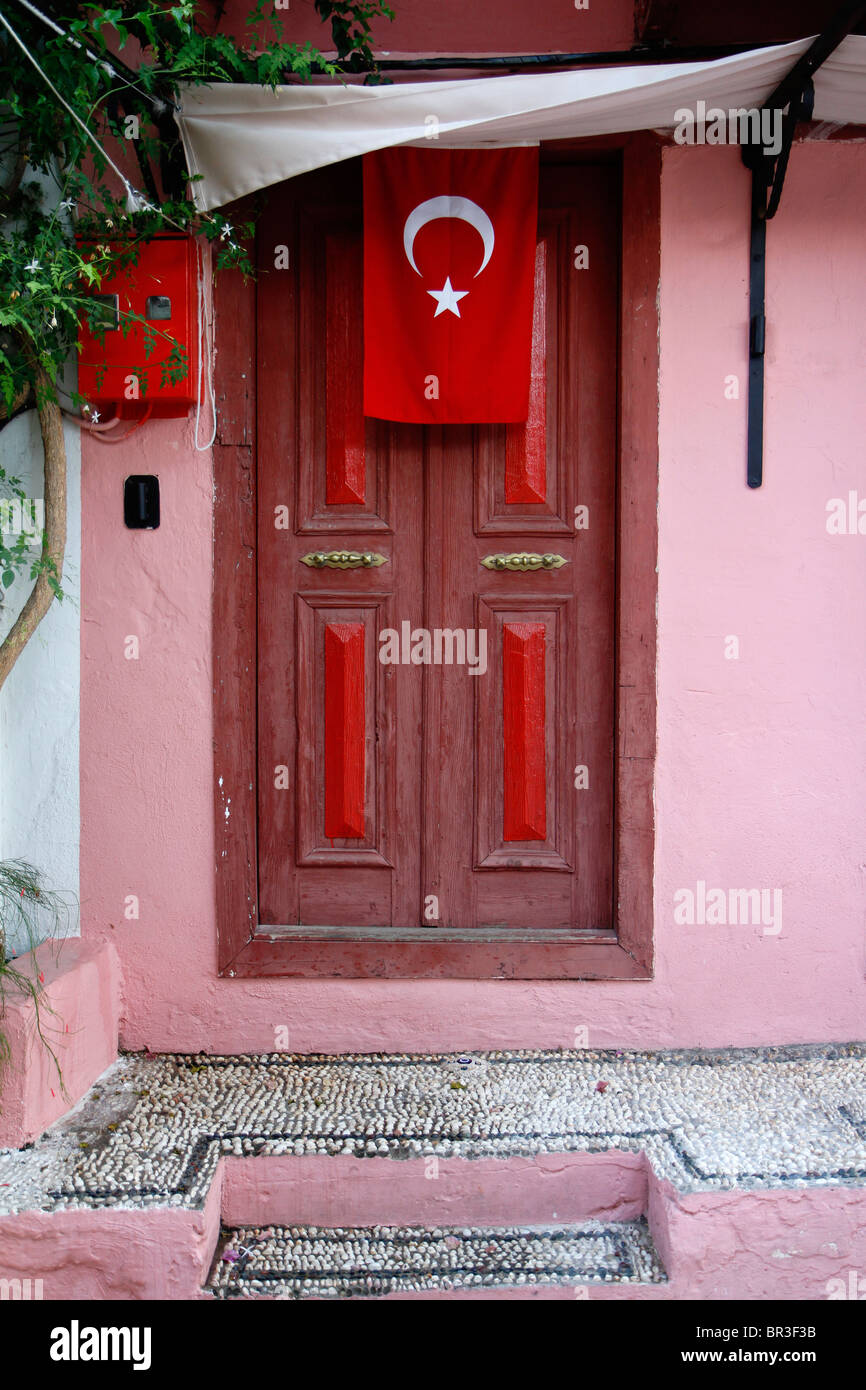Colourful village doorway with Turkish flag, Kas, Turkey. - Stock Image