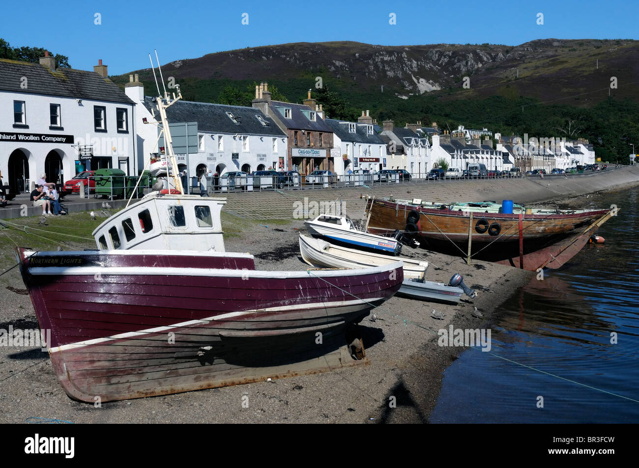 Seafront, shops and boats in Ullapool - Stock Image