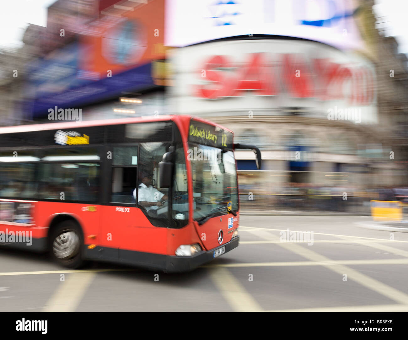 London bus at speed through Piccadilly Circus - Stock Image