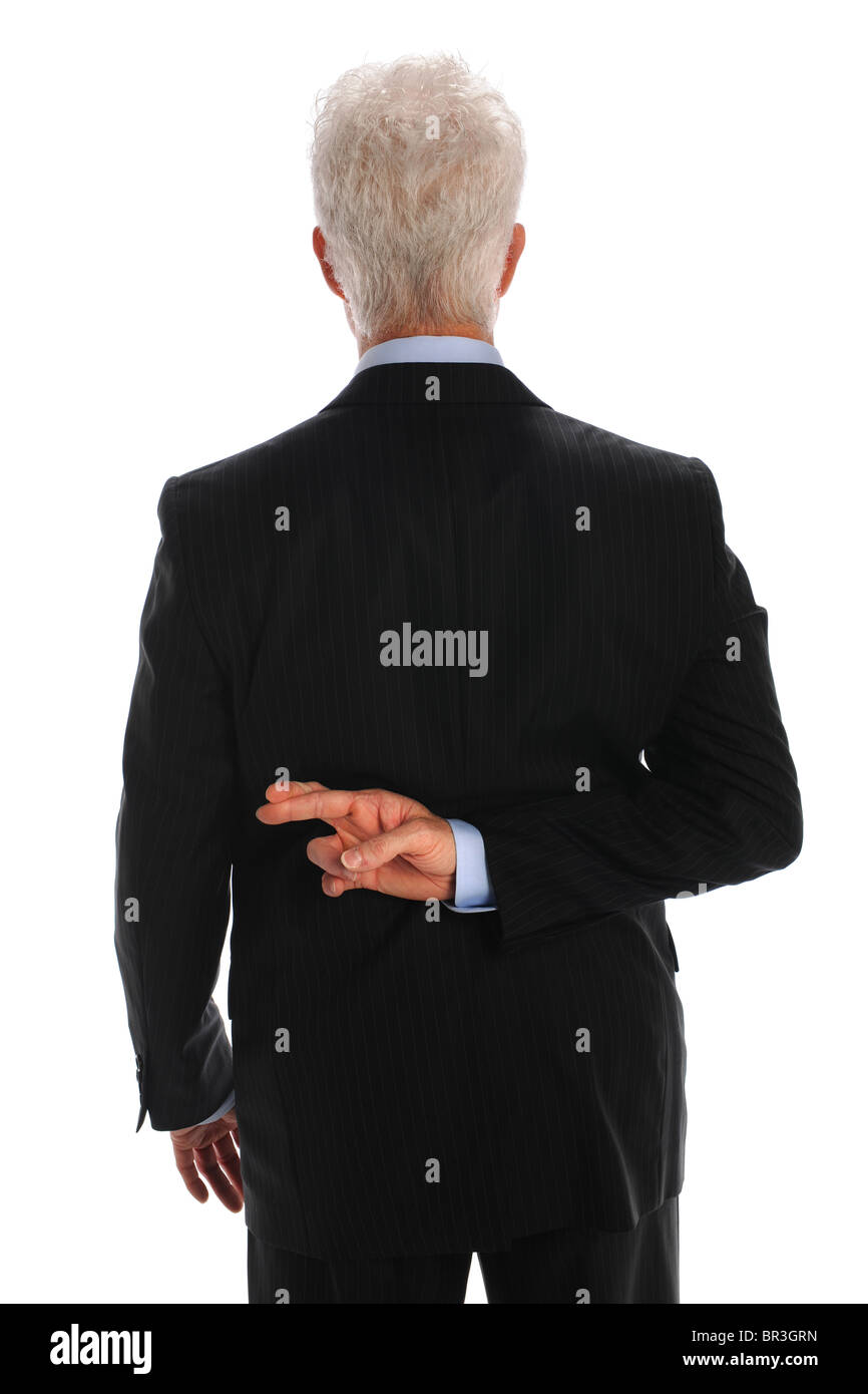 Mature businessman with fingers crossed behind back isolated over white background - Stock Image
