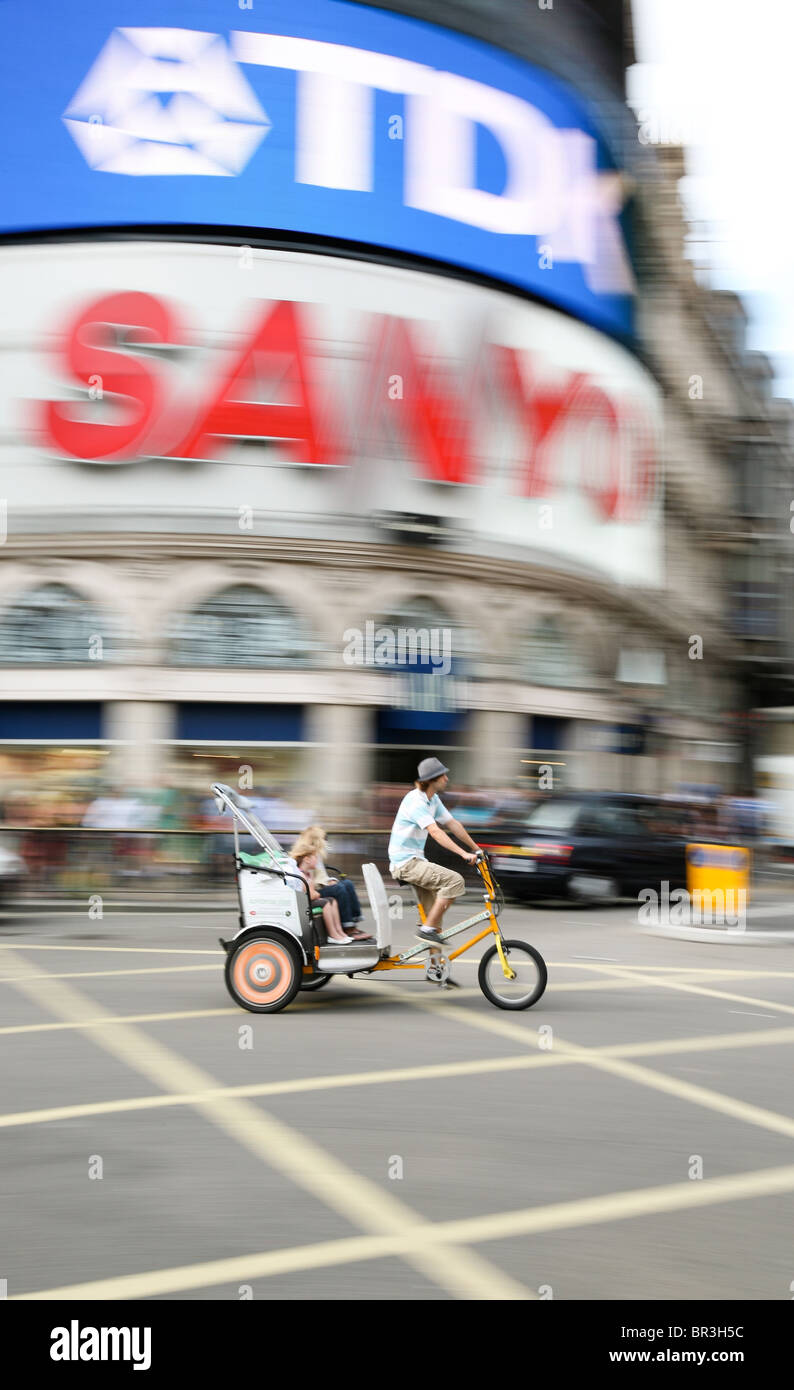 Cycle rickshaw passing through Piccadilly Circus, London Stock Photo