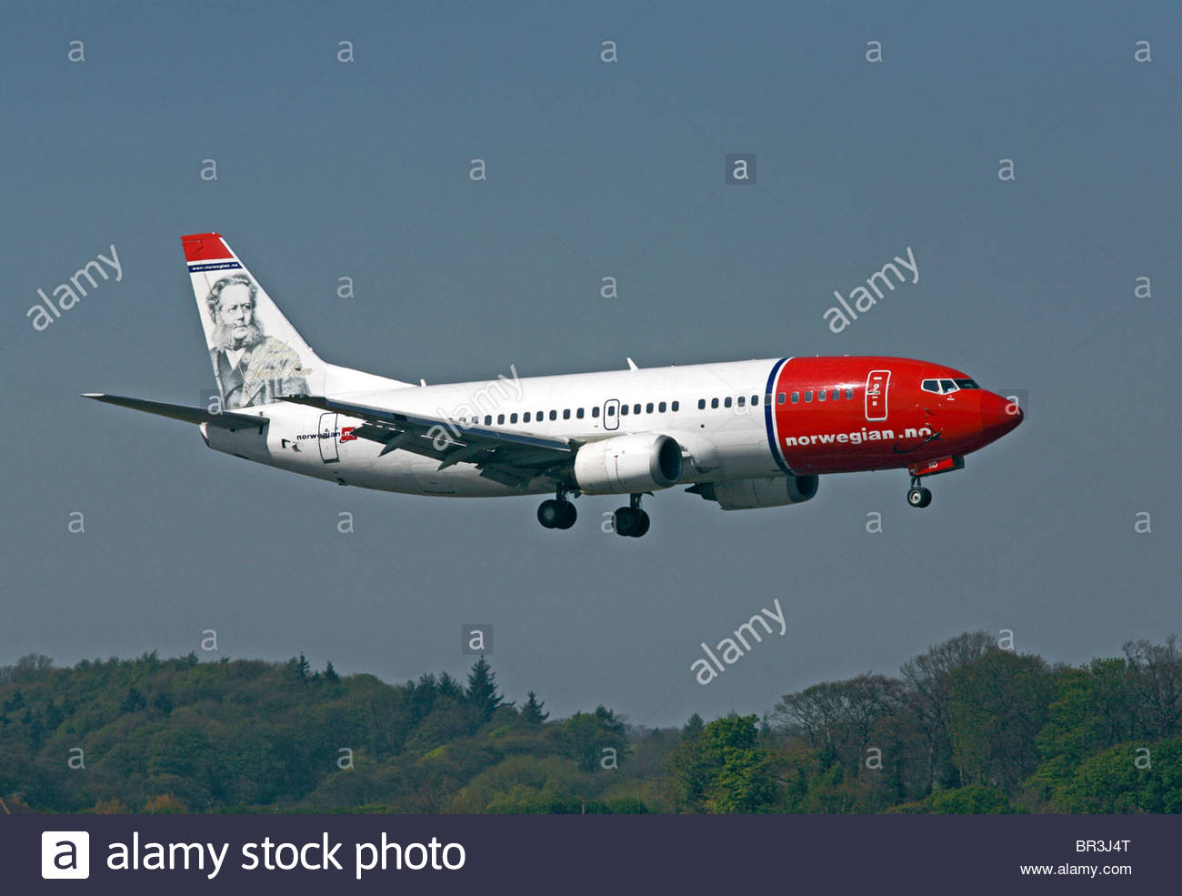 Norwegian Air Boeing 737 approaching runway Stock Photo