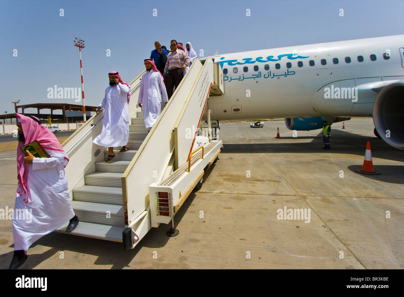 Jazeera Airways Airplane disembarking at Kuwait International Airport - Stock Image