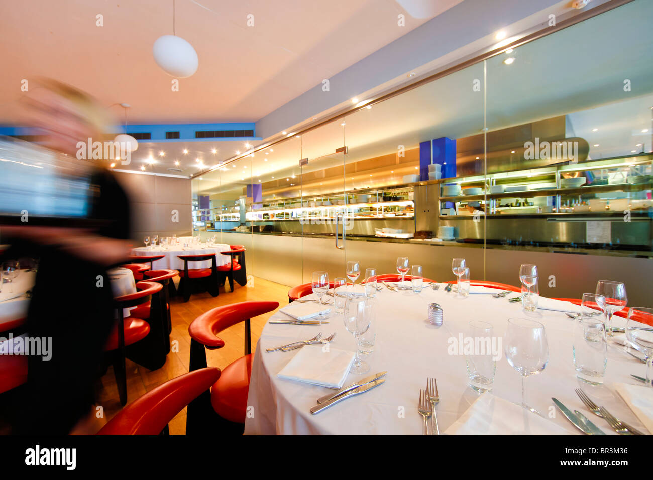 Tables laid ready for service in a restaurant in Birmingham City Center. - Stock Image