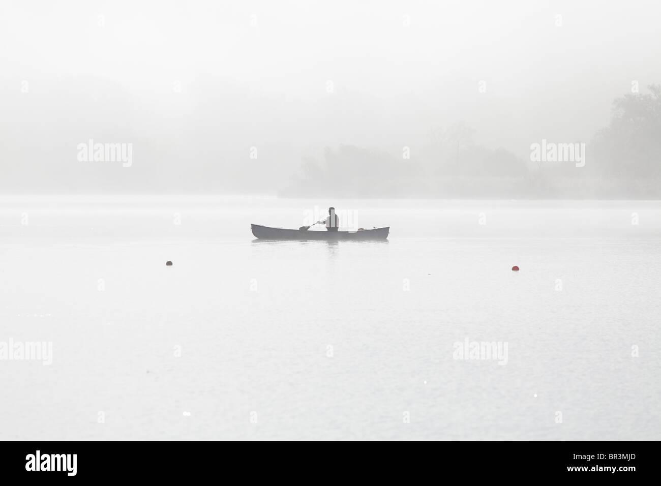 A canoe on a misty morning, Scotland, UK - Stock Image