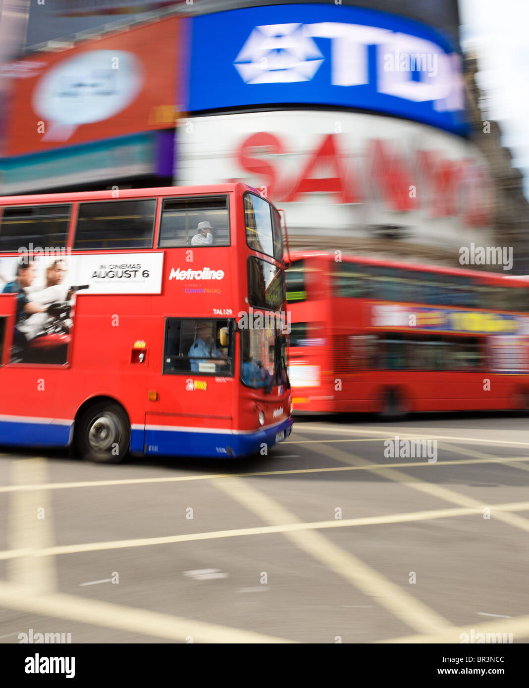 Buses in Piccadilly Circus, London - Stock Image