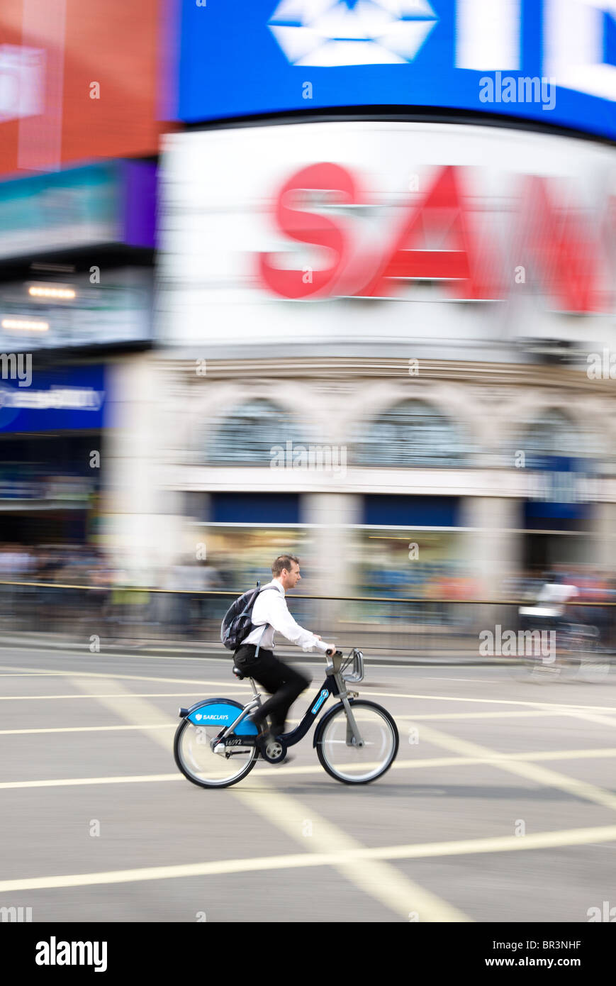 Barclays Cycle Hire bike travelling through Piccadilly Circus, London - Stock Image