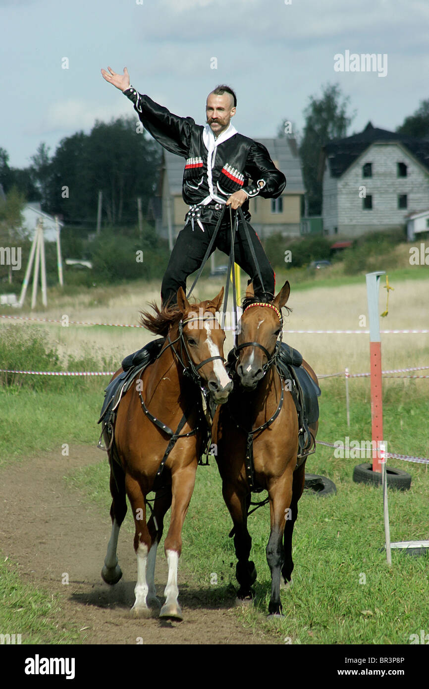 Alexei Subin in action during the Championship of Saint-Petersburg on military-applied types of equestrian sport - Stock Image