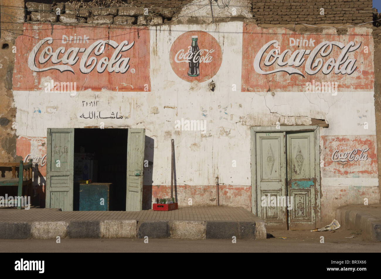 Facade of a building with Coca-Cola advertising. Luxor. Egypt. - Stock Image