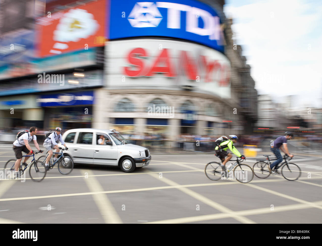 Cyclists in Piccadilly Circus, London - Stock Image