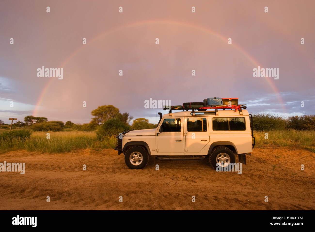Rainbow over a Land Rover - Stock Image