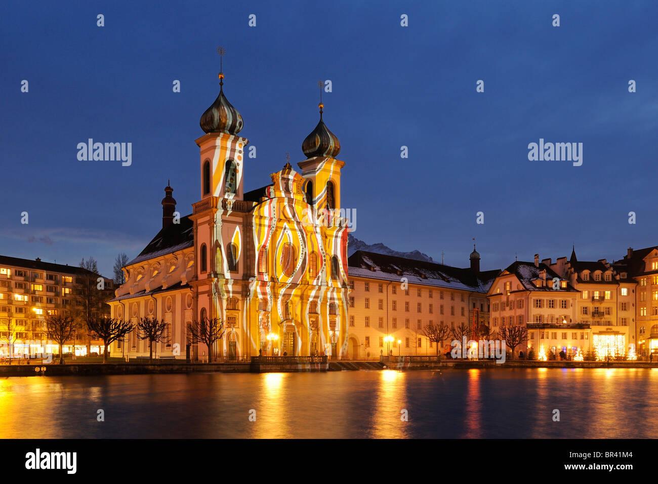 Jesuit Church illuminated by light artist Gerry Hofstetter with Christmas light, Lucerne, Switzerland, Europe - Stock Image