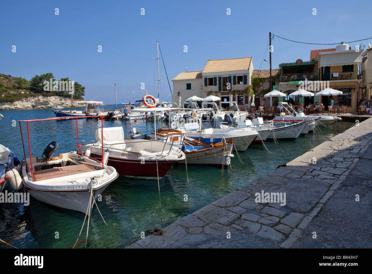 Boats moored in Loggos Harbour, Paxos - Stock Image