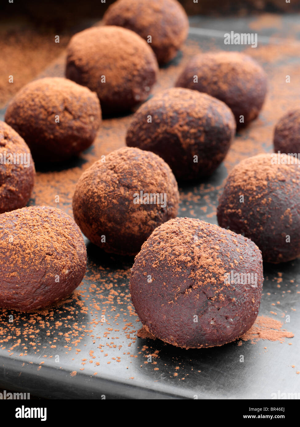 Chocolate truffles dusted with cocoa powder - Stock Image