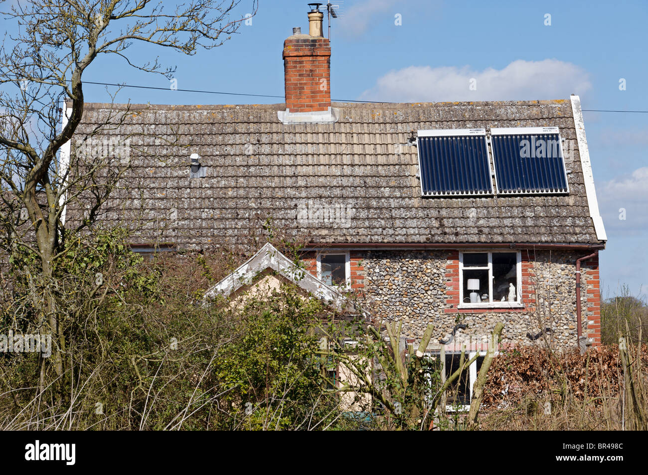 House with solar thermal evacuated vacuum tubes for the hot water heating system Stock Photo