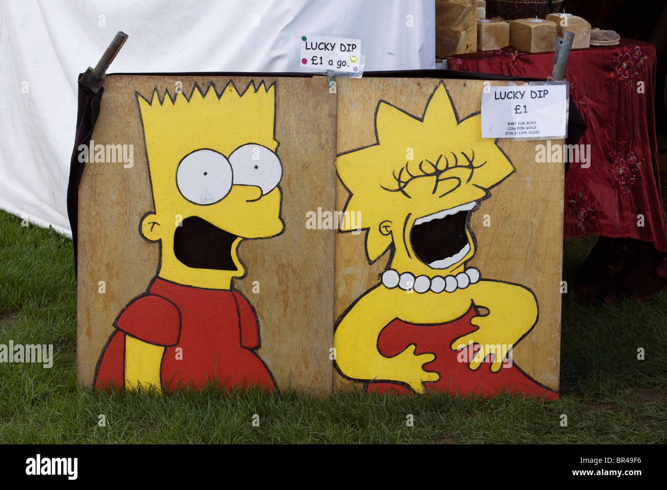 Wooden Lucky dip boxes with Bart and Lisa Simpson - Stock Image