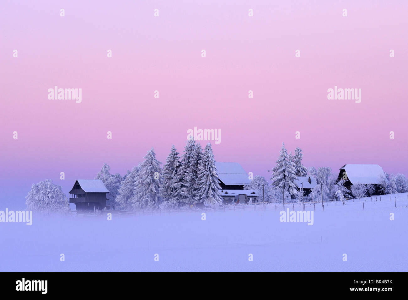 Winter mood at dawn with an old Spycher, or barn, in the foreground, Lindenberg, Aargau, Switzerland, Europe - Stock Image