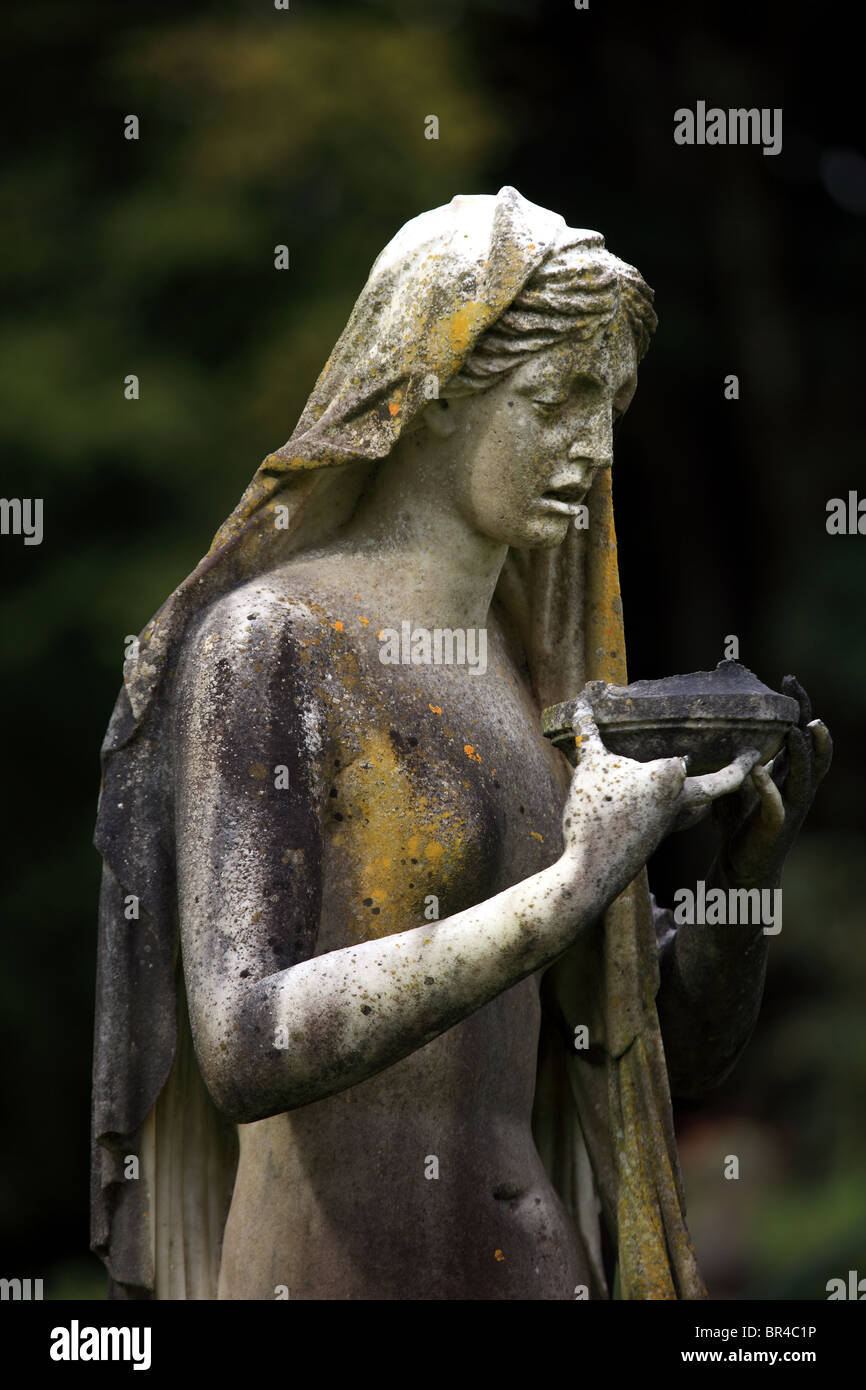 Statue of Artemesia with a cup of poison in the grounds of Torosay Castle on the Isle of Mull - Stock Image