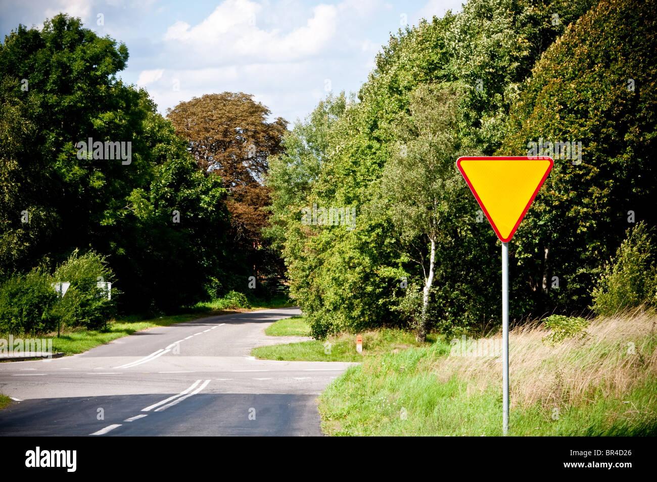 yield sign near crossroad - Stock Image