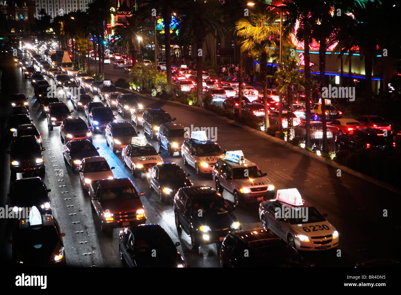 Downtown traffic at night along The Strip, Las Vegas Boulevard, Las Vegas, Nevada - Stock Image