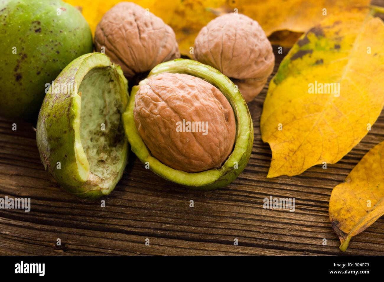 Autumn walnuts on wooden board - Stock Image