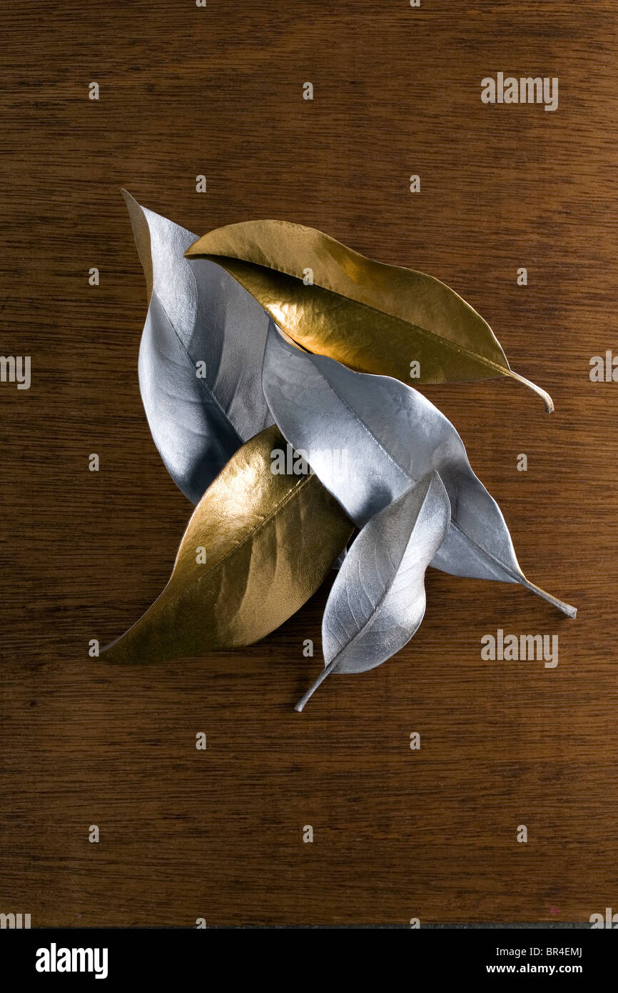 gold and silver leaves on wood - Stock Image