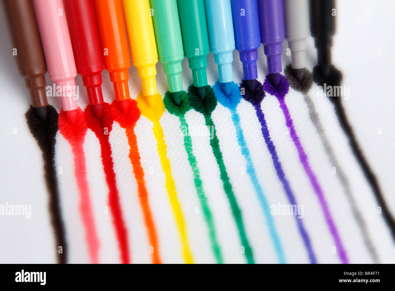 Colorful markers on white background. With beautiful vibrant colors, great for kids, color, school , design or print - Stock Image