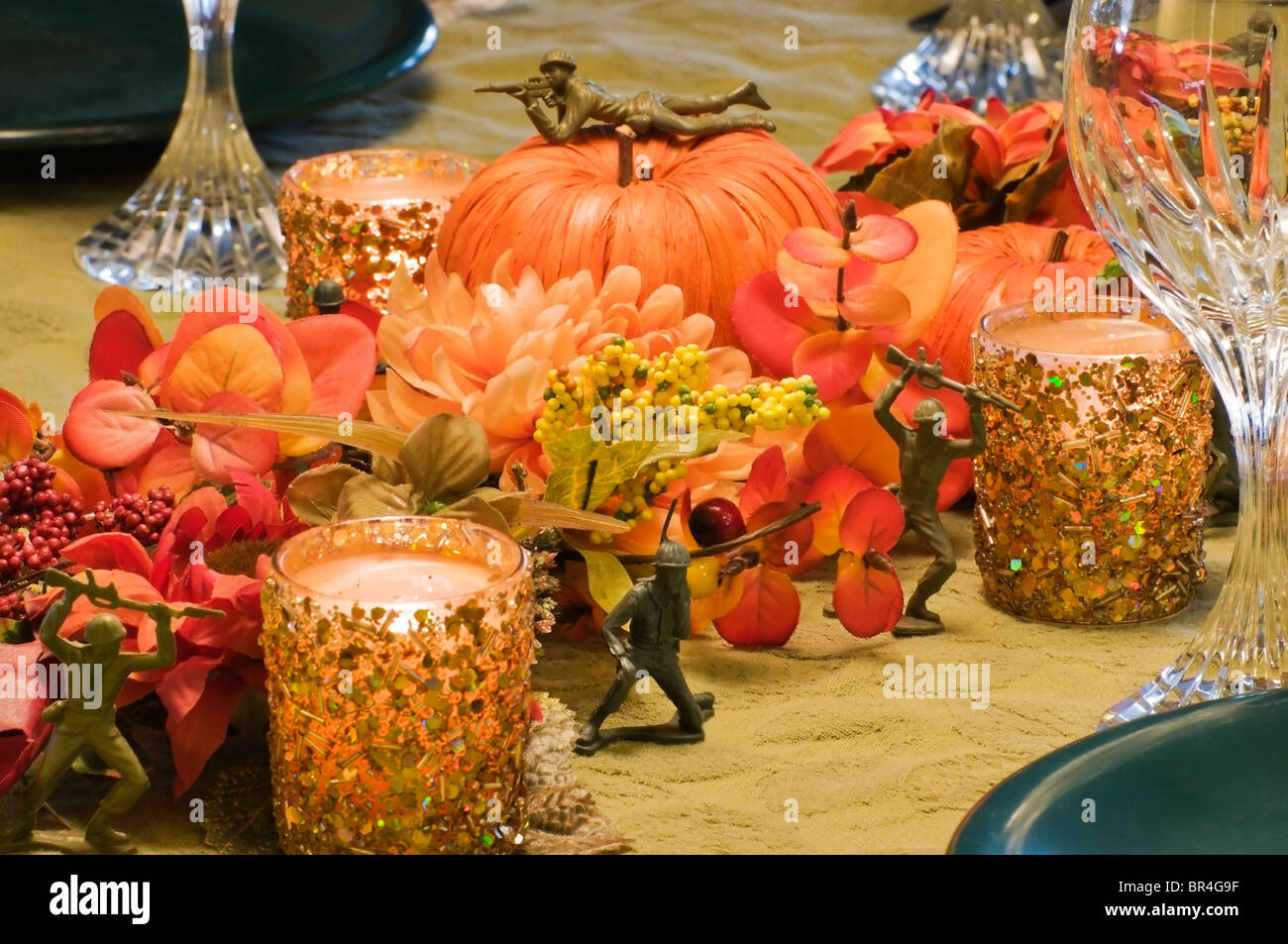 Military themed autumn centerpiece fills table with silk flowers military themed autumn centerpiece fills table with silk flowers straw pumpkins glowing candlelight and plastic toy soldiers mightylinksfo
