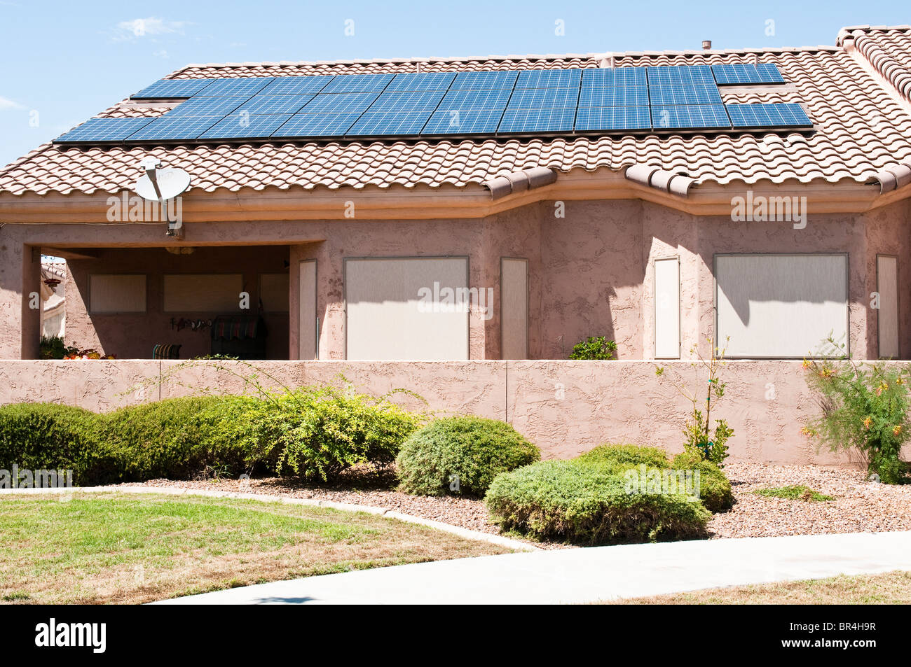 Roof mounted solar panels supply electrical energy to suburban homes in Arizona. - Stock Image