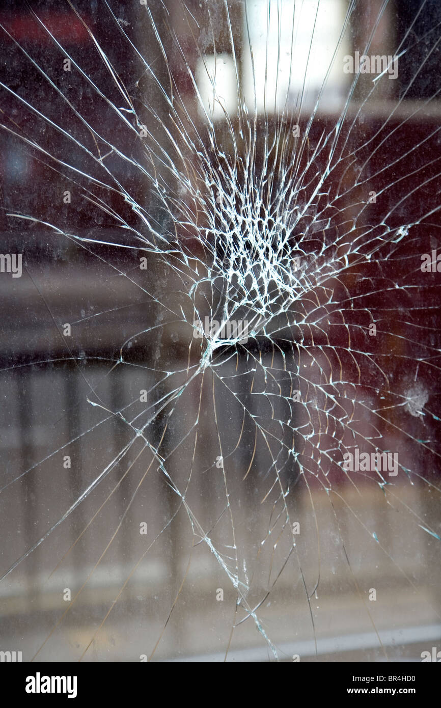 Cracked glass on shop front - Stock Image