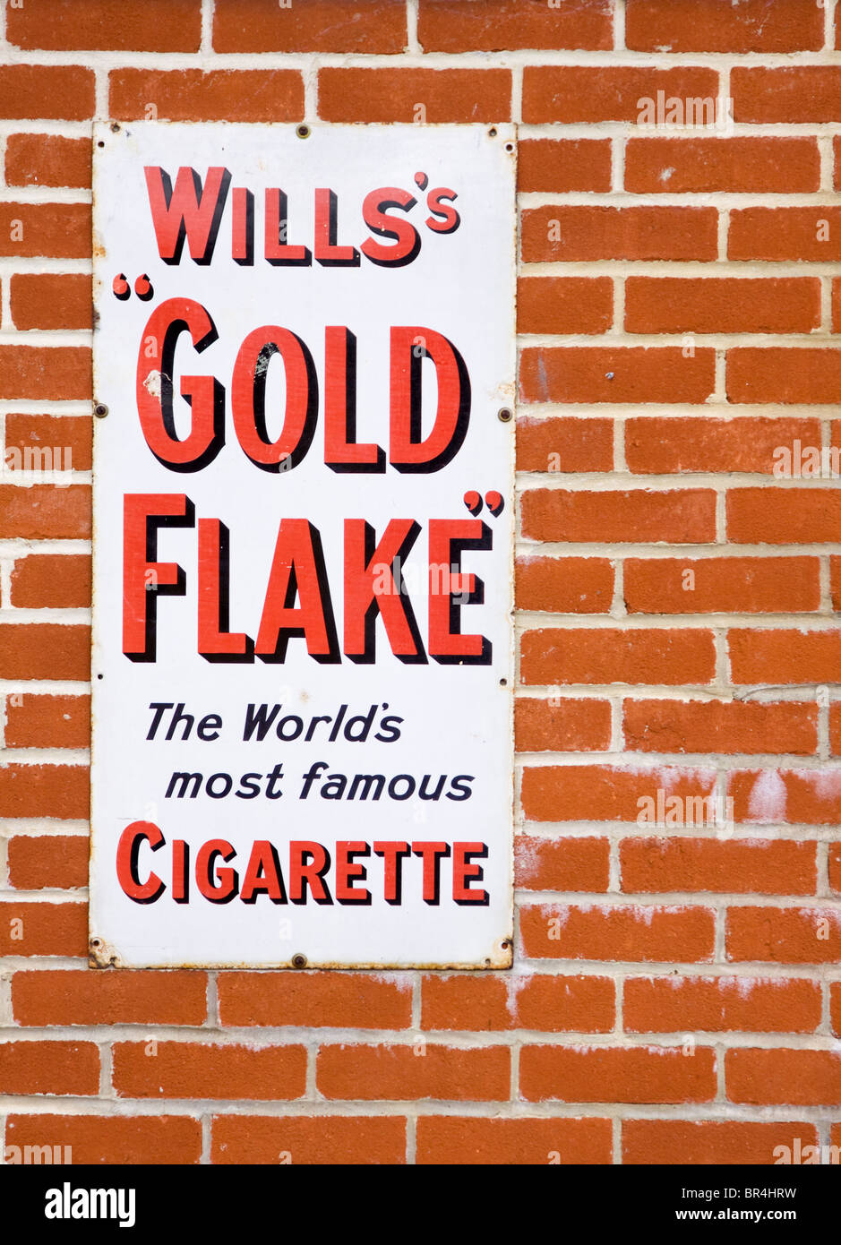 Old metal advertising sign for Wills's Gold Flake Cigarettes - Stock Image