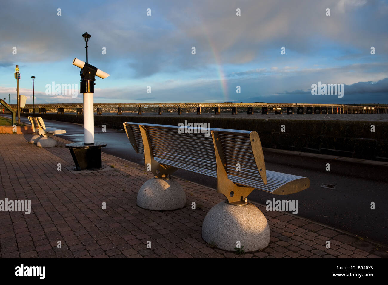 Rainbow, coastal telescope and seating at the River Tay bridge and Stainless steel bench at the Riverside, Dundee - Stock Image