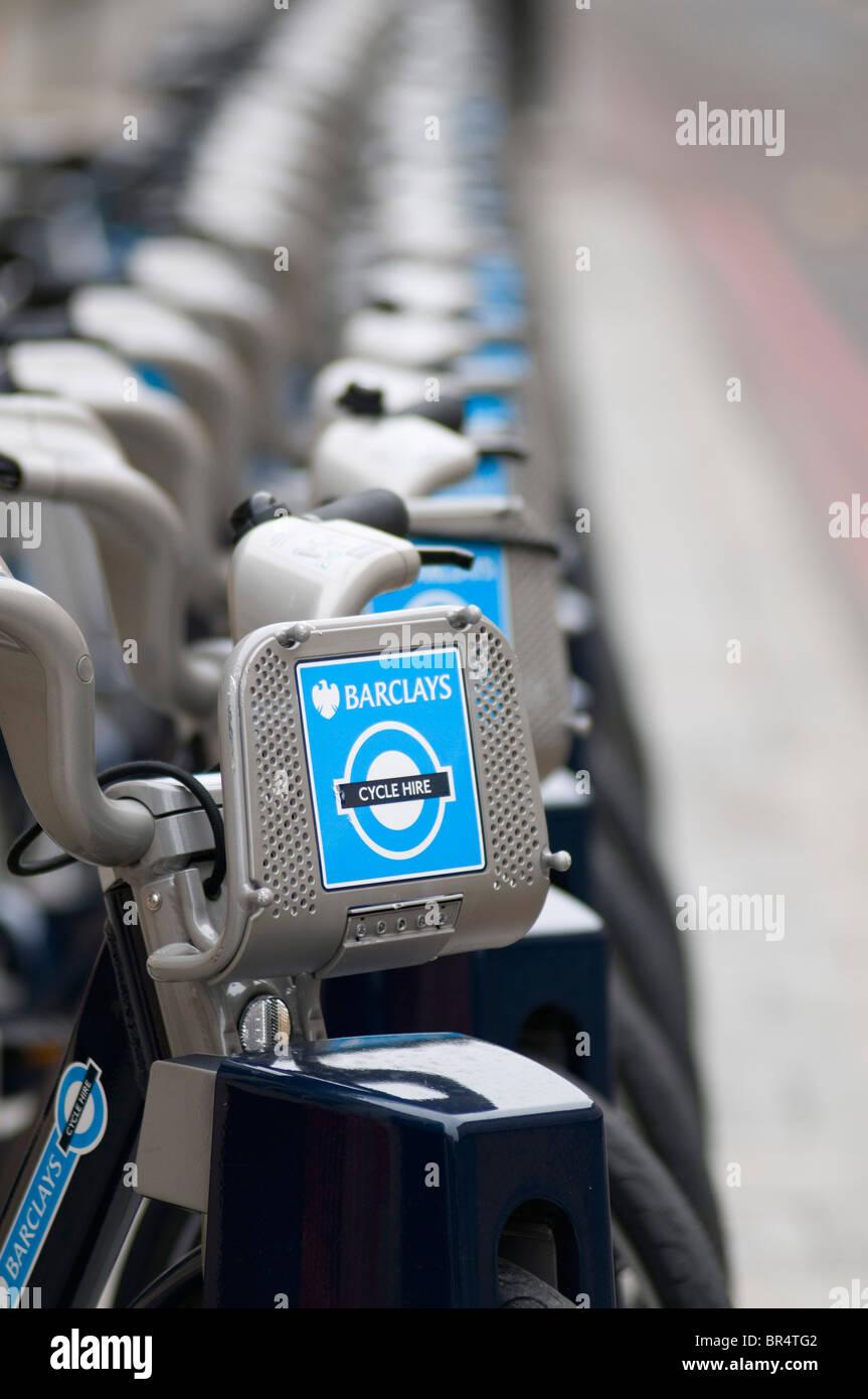 Row of bicycles, Barclays TFL Cycle Hire Scheme docking station, London, United Kingdom - Stock Image