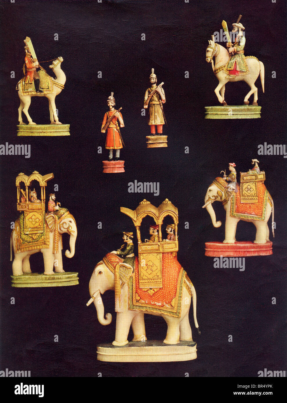 Pieces from a complete chess set in carved and coloured ivory. Made in Delhi, India c.1790 for the Begum Samru. - Stock Image