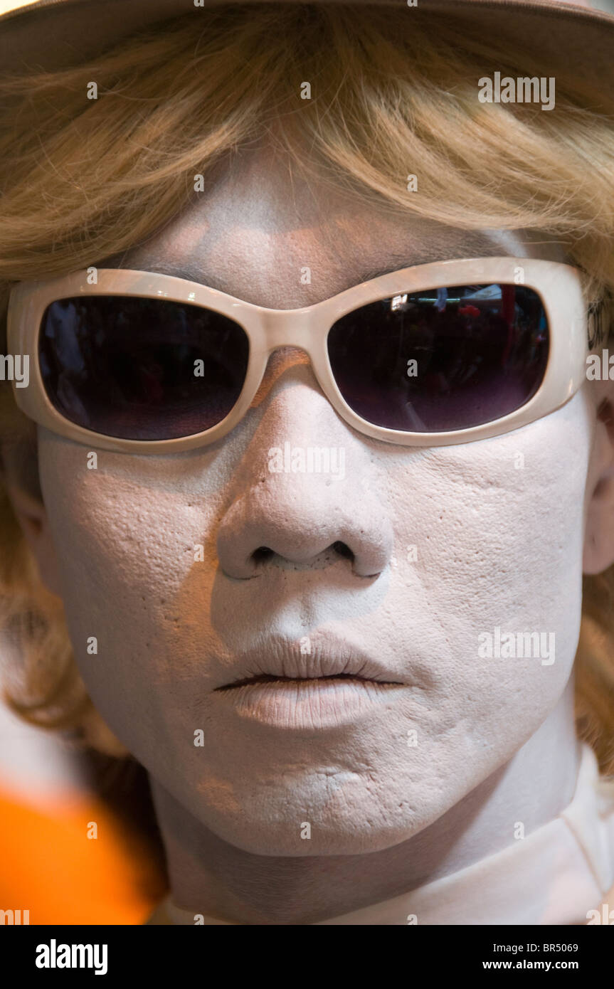 street mime posing at the Silom Street Fair in Bangkok Thailand - Stock Image