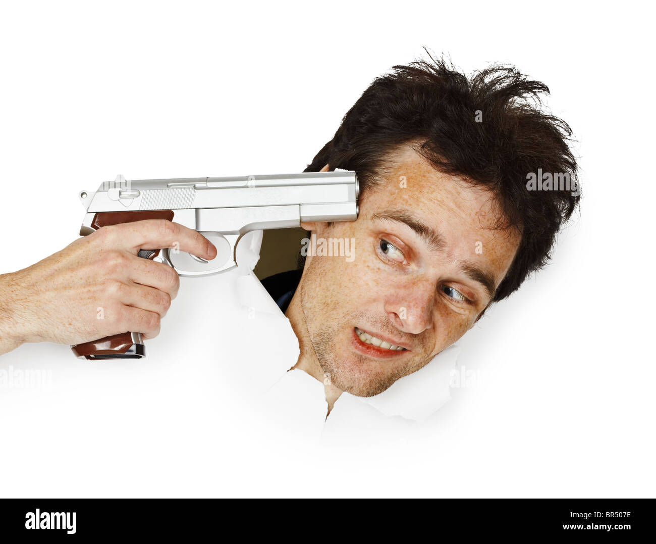 The gun aims at the head of a frightened man - Stock Image