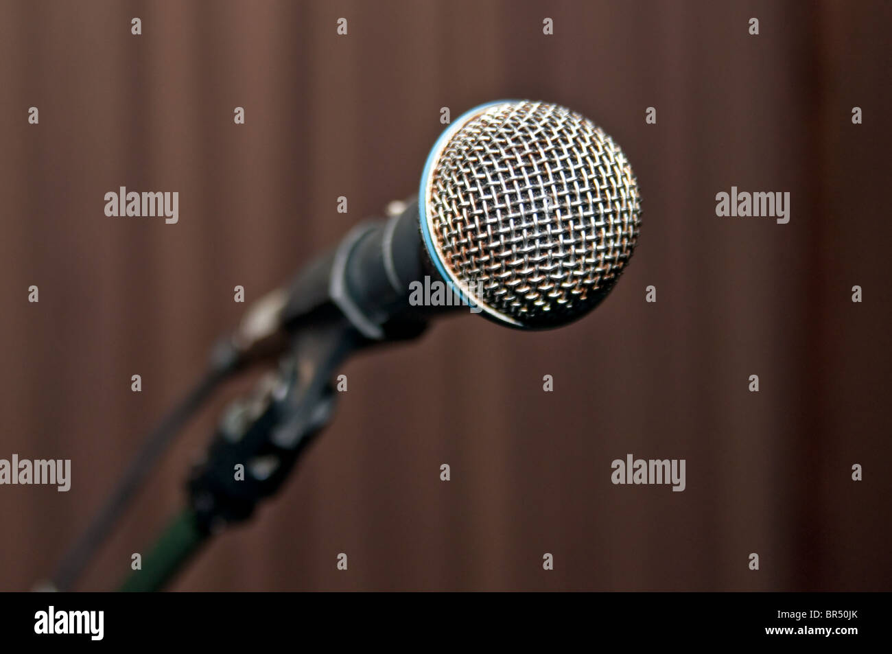 metal microphone on stage before show - Stock Image