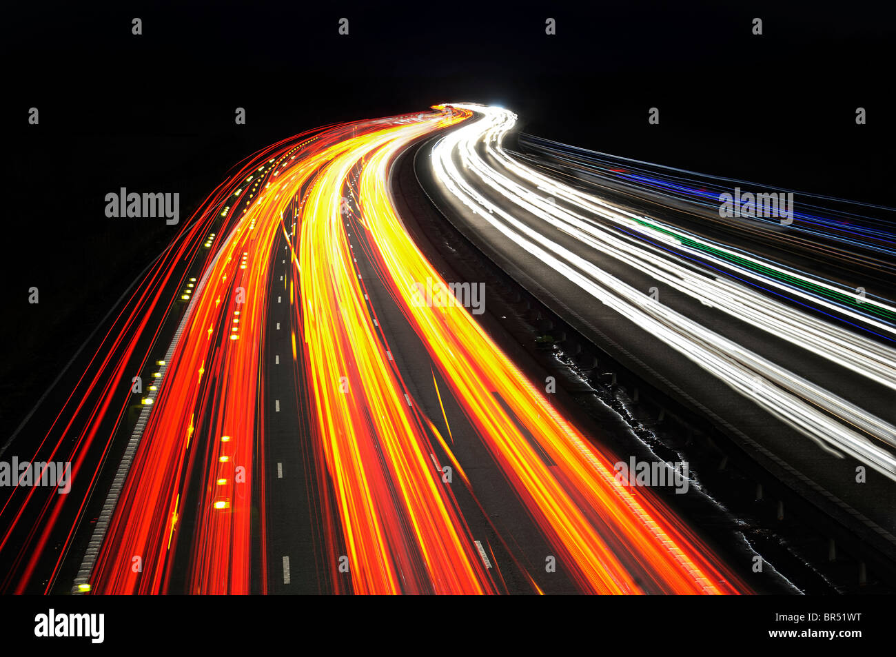 motorway,night,traffic,trail,lights, cars,fast,moving,blur,speed,flow ,bright,movement, - Stock Image