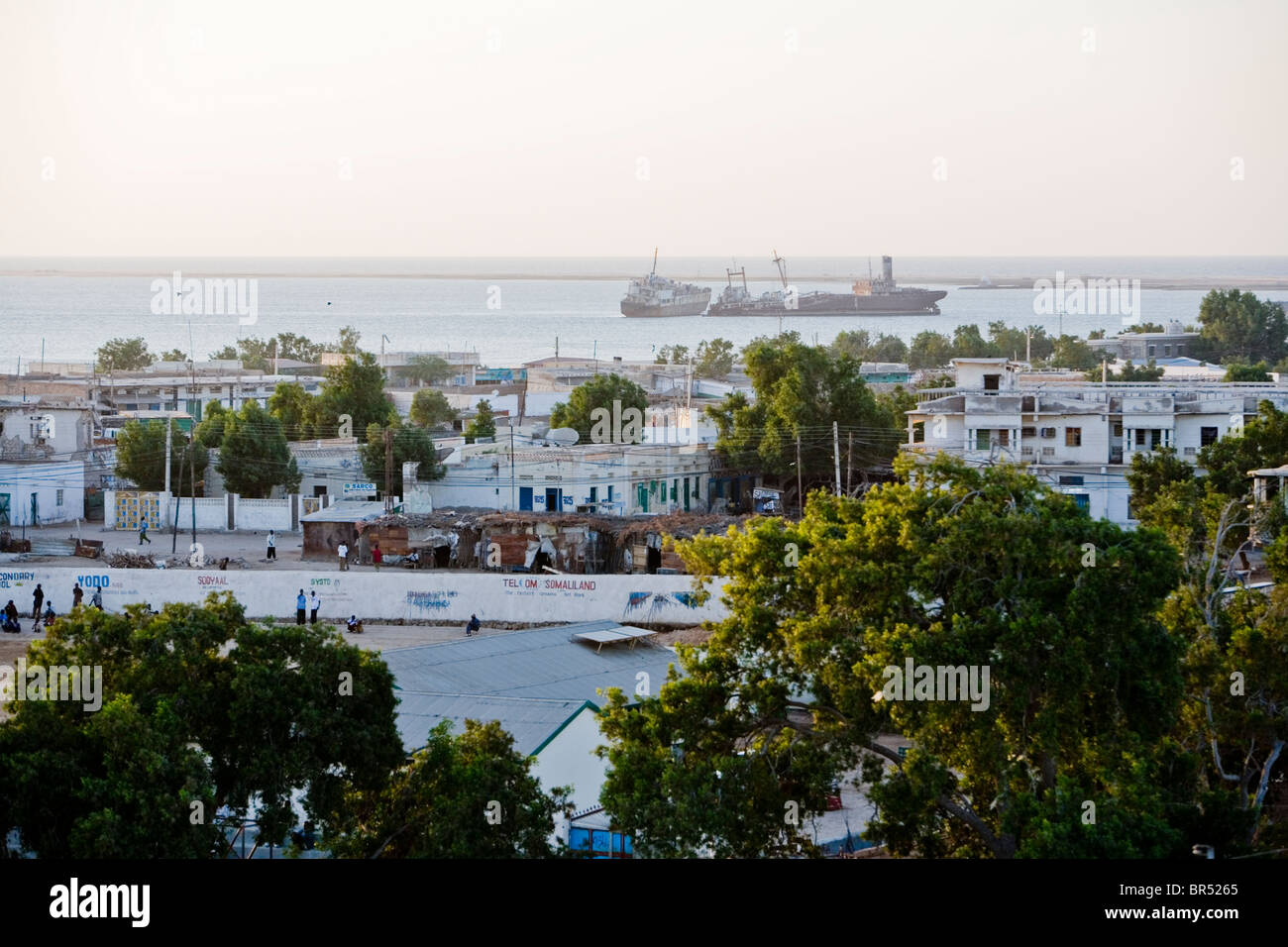 View of the town of Berbera with abandoned boats in the background. - Stock Image