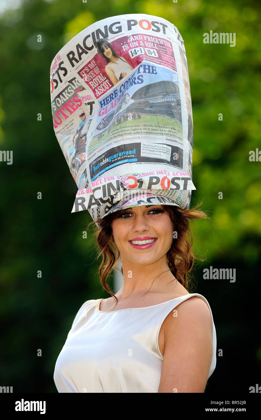 A female race goer wearing a racing post themed hat attends day two of Royal Ascot 2010 - Stock Image