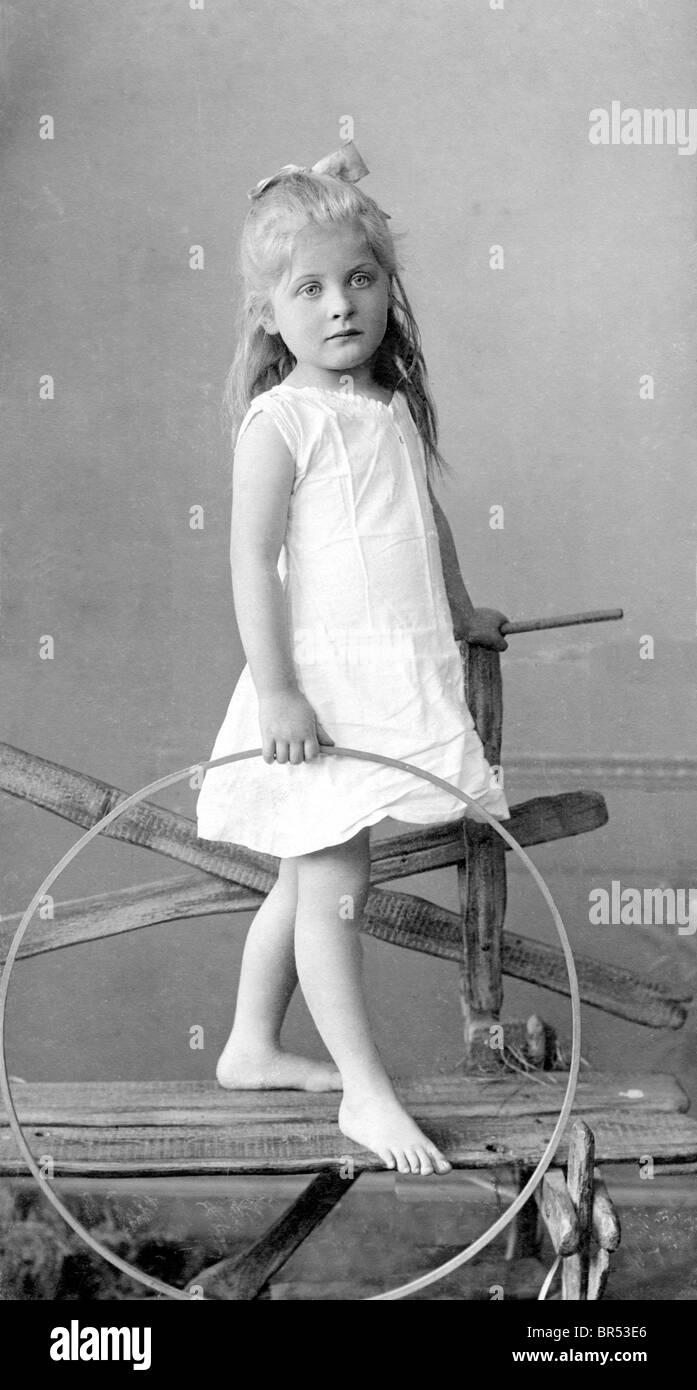 Historic photograph, girl with a hula hoop, around 1913 - Stock Image