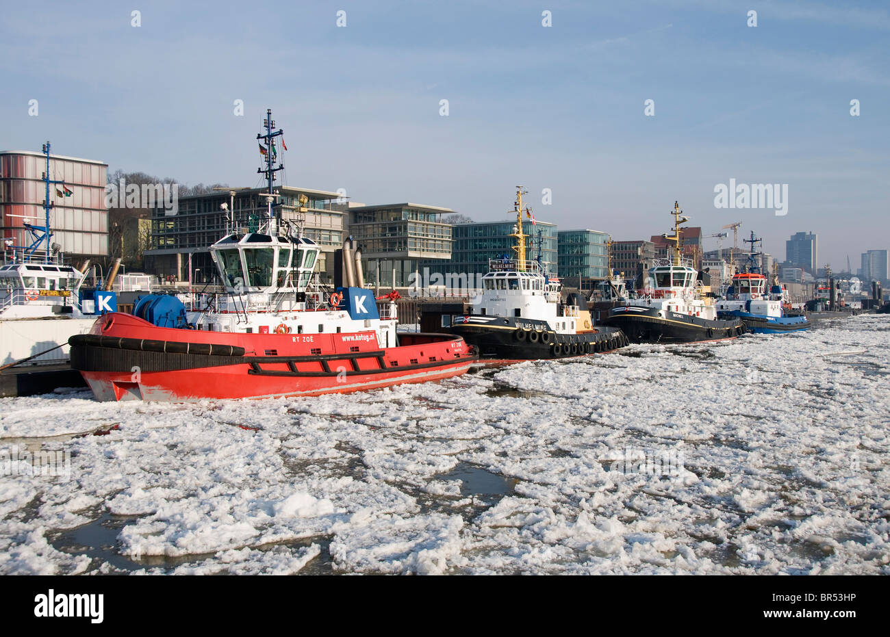 Harbour tugs anchored in front of Altona at the Port of Hamburg, at back the Elbperlen, Hamburg, Germany, Europe - Stock Image