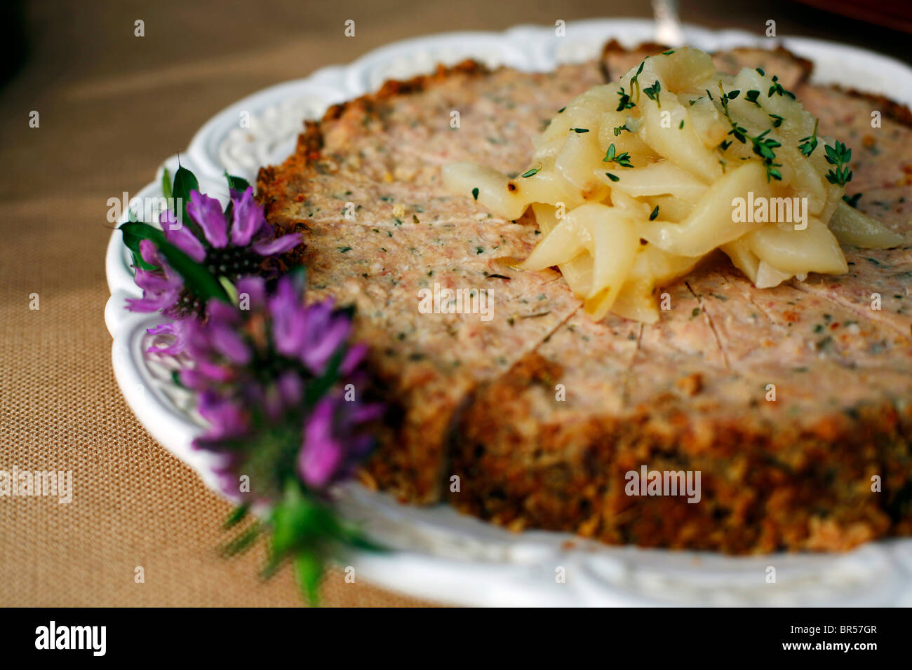 Rabbit pie with poached pears appetizer. - Stock Image