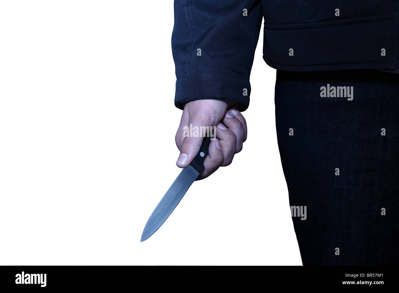 Hand of a young male holding a knife cut out on a white background - Stock Image