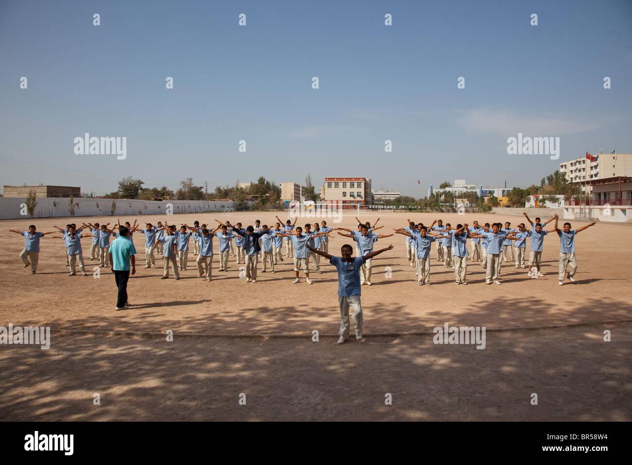 School Yard exercises in Turpan Xinjiang China. - Stock Image